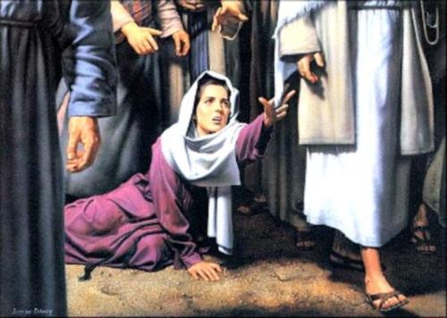 tocando el manto de Jesus